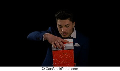 Man opens gift box and has a wow reaction