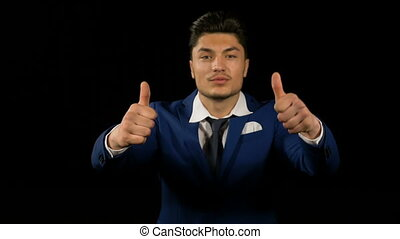 Joyful young business man showing thumbs up