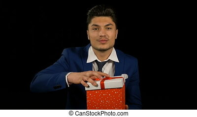 Businessman showing and opening a surprise gift box package