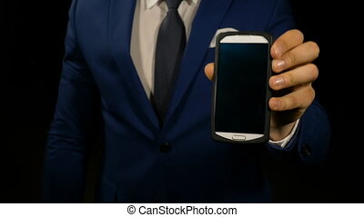 Elegant office manager pointing at a smart phone display