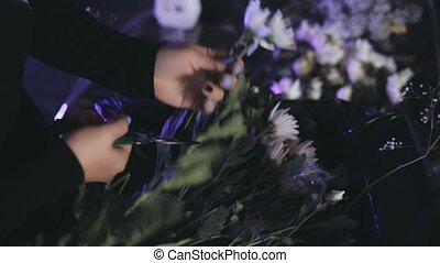 Close-up view of female hands cutting the flowers from...