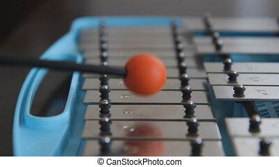 Glockenspiel. - Playing a blue children%u2019s glockenspiel...