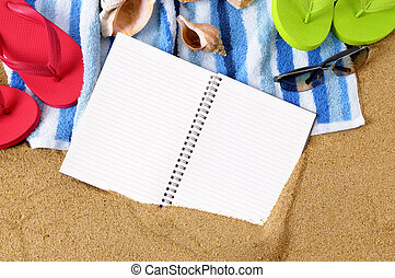 Beach background with towel, flip flops and blank notebook.