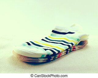 collection of colored socks with vintage filters effect