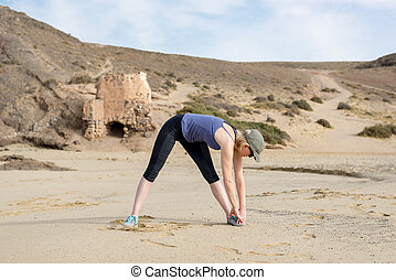 Woman in Sportswear Bent Over Warm Up Stretching - Woman in...