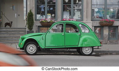 Classic green car - Classic old green Citroen 2CV parked in...