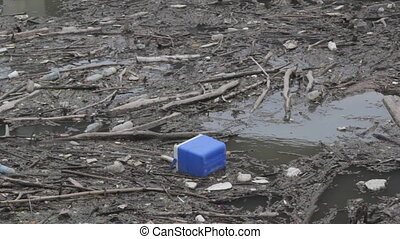 Garbage in the river. - Garbage (including plastic bottles...