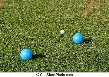 Blue and White Bocce Balls on Green Grass
