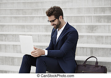 Businessman laptop - Businessman using laptop on steps