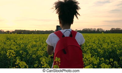 African American girl teenager female young woman with red...