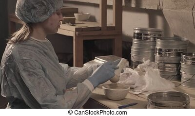 Scientist preparing preparations for research. - Scientific...