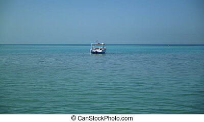 Lonely boat in the sea - A lonely boat is anchored in the...