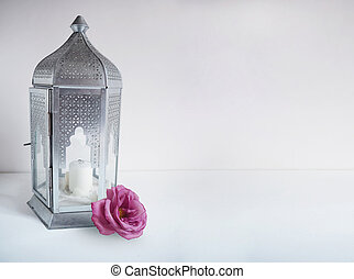 Ornamental silver Arabic lantern with rose flower on the...