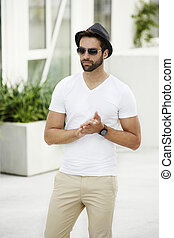 Cool dude in white with shades and hat