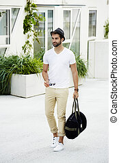 Cool dude with bag - Cool hipster guy carrying sports bag