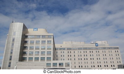 Hospital with timelapse clouds. Wid - Hospital with blue sky...