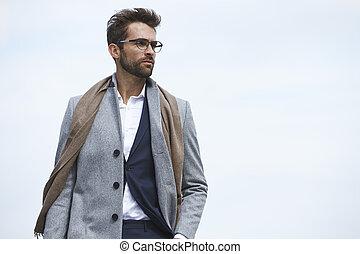 Overcoat man - Businessman in overcoat, looking away