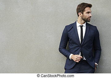 Business dude on wall - Business dude against wall, looking...