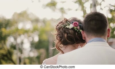 Back view of lovers leaning on each other. Close-up of their...