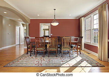 Modern dining room with salmon colored walls