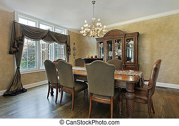 Dining room in luxury home with wood buffet