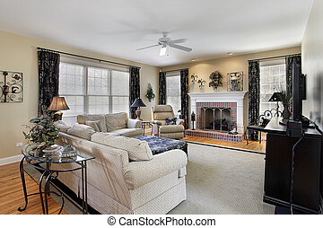 Family room with brick fireplace - Family room in suburban...