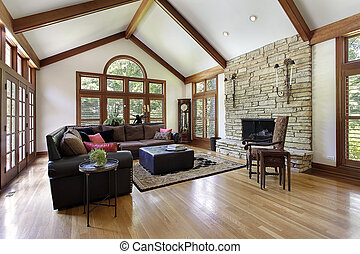 Family room with stone fireplace - Family room in luxury...