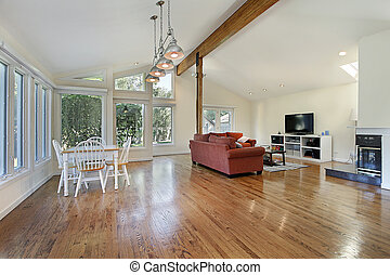 Family room with ceiling wood beam