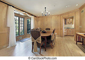 Dining room with oak wood paneling