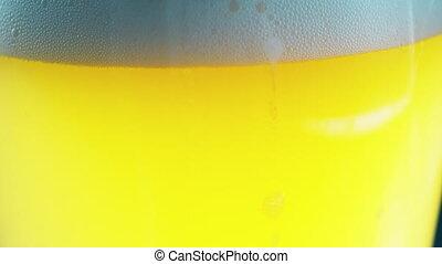 White foam sliding down of beer glass. UltraHD video