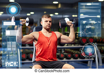 young man with dumbbells flexing muscles in gym - sport,...