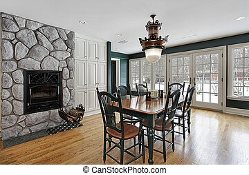 Breakfast room with stone fireplace