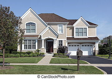 Home with brown cedar roof - Home in suburbs with arched...