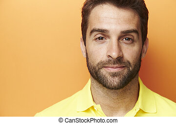 Brown eyed guy in orange studio, portrait