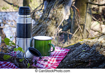 Thermos and cup - thermos and a cup used in nature