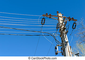 Electricity concrete pole with electrical connections cable and high voltage isolators