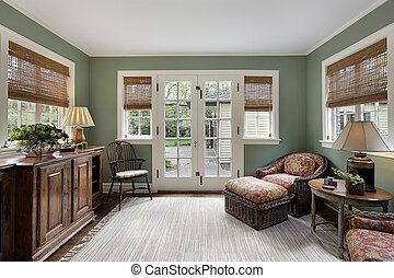 Den with doors to patio - Den in suburban home with doors to...