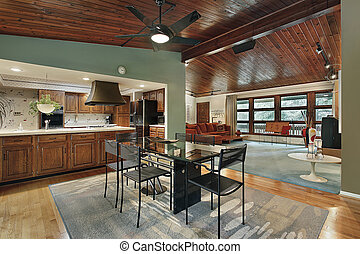 Kitchen with glass table - Kitchen in suburban home with...
