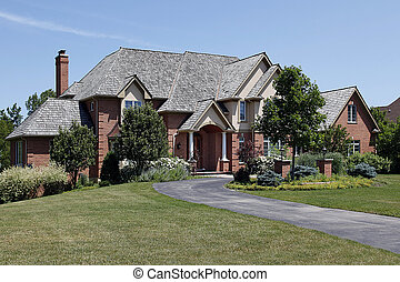 Large brick home with cedar roof - Large brick home with...