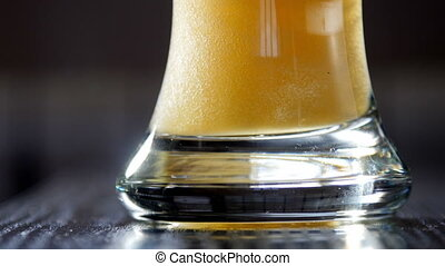Slow motion of pouring light beer into glass. UltraHD video...