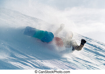 snowboarder is riding from snow hill and fall down -...
