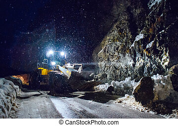 rockfall and landslide in the winter night in the mountain