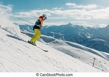 girl with special ski equipment is riding very fast in the...