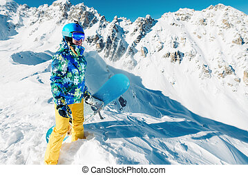 woman is standing with snowboard on the - Snowboarder is...