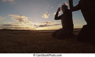 Religious two men muslim the man praying nature sunset...