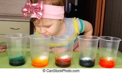 The child conducts experience and experiment with...