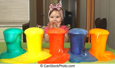 A little girl is experimenting and surprised.