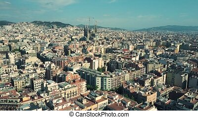 Barcelona city aerial rising shot, Spain. Famous Sagrada...