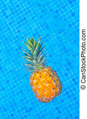 Pinapple near pool - Whole pinapple in pool blue cool water