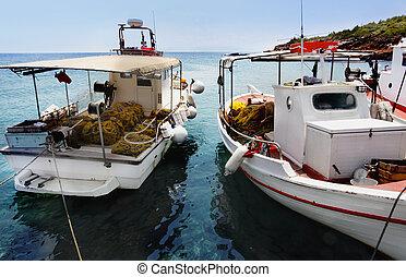 Fishing boats docked at a harbor